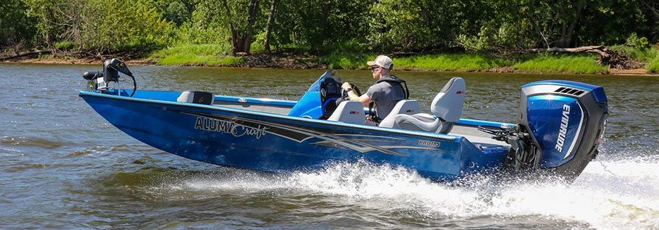 Male Angler Drives Blue Pro 185 Bass Boat on River